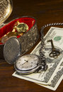 Retirement and financial planning with pocket watch Stock Photos