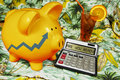 Retirement and pension planning golden piggy bank with calculator on hawaiian shirt Stock Photography