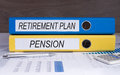 Retirement plan and pension folders office marked with on desktop with spreadsheets calculator pen Stock Photo