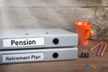 Retirement Plan and Pension - two folders on wooden office desk Royalty Free Stock Photo
