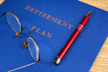 Retirement savings plan with pen and eye glasses Stock Photography