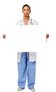 Retrato del doctor confiado holding blank billboard Imagenes de archivo