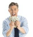 Retrato del hombre de negocios emocionado showing dollar bills Foto de archivo libre de regalías