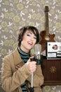 Retro 60s singer woman microphone guitar reel tape Royalty Free Stock Photo