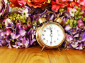 Retro alarm clock with flowers background Royalty Free Stock Photo