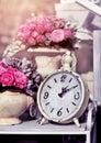 Retro alarm clock with flowers. Royalty Free Stock Photo