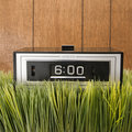 Retro alarm clock in grass Royalty Free Stock Images