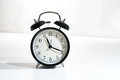 Retro alarm clock with time reading nineteen past eleven Royalty Free Stock Photo