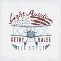 Retro aviation grunge vector design airplane and wings Royalty Free Stock Photo