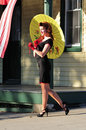 Retro beauty with a parasol classic standing yellow vintage Stock Photos