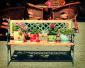 Retro bench. Flowers in pots Royalty Free Stock Photos