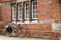 Retro bike against the brick wall of an old building with nobody Stock Photography