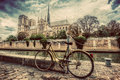 Retro bike next to Notre Dame Cathedral in Paris, France. Vintage Royalty Free Stock Photo
