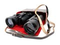 Retro binoculars in a bag on a white background Royalty Free Stock Photography