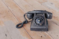 Retro black old telephone retro style on wooden background Royalty Free Stock Photography