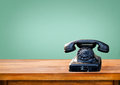 Retro black telephone on wood table Royalty Free Stock Photo