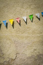 Retro bunting grungy against an old building wall Royalty Free Stock Images