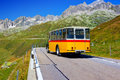 Retro bus alps road with Royalty Free Stock Photo