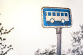 Retro bus stop sign in blue color Stock Photos