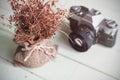 Retro Camera With Dry Flower O...