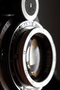 Retro camera lens close-up. Stock Photos