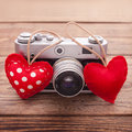 Retro camera with red hearts on wooden background a valentine s day greeting card Stock Image