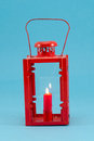Retro candlestick handle red candle burn lamp blue Stock Image