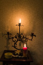 Retro candlesticks with candles on wooden table Royalty Free Stock Photo
