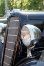 Retro car day headlight radiator close up Stock Photo