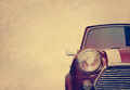 Retro car head light on paper grain background, vintage color