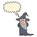 Retro cartoon wizard with speech bubble Stock Photography