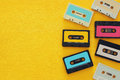 Retro cassette tape collection over yellow wooden table. top view. copy space Royalty Free Stock Photo