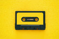 Retro cassette tape over yellow wooden table. top view. Royalty Free Stock Photo