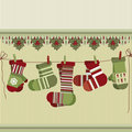 Retro Christmas background with socks and mittens. Royalty Free Stock Images