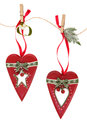 Retro christmas decorations old fashioned red heart bauble with mistletoe and fir on a string line over white background Royalty Free Stock Images
