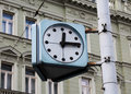Retro clock on the street shot taken in prague Royalty Free Stock Photography