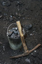 Retro coal mining. Pickaxe and the bucket full of lumps of coal Royalty Free Stock Photo