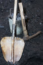Retro coal mining. Spade with a pickaxe and the bucket in mine Royalty Free Stock Photo