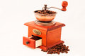Retro coffee mill and cup of coffee on white backgrownd