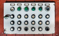 Retro control panel with buttons, colored lights and switches Royalty Free Stock Photo