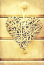 Retro cross processed image of hearts on wood macro effect willow heart wooden background Stock Photography