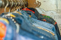 Retro denim jackets on hangers on a rail Royalty Free Stock Photo