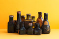 Retro design bottles still life photo. Colorful dirty glass flacon collection. shallow depth of field. Soft yellow Royalty Free Stock Photo