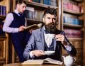 Retro detectives work on investigation in antique room. Royalty Free Stock Photo