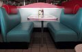 Retro diner booths these turquoise and red leather at the take us back to the s Royalty Free Stock Images