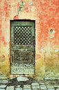 Retro door old vintage wooden and red wall Royalty Free Stock Image