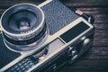 Retro film camera on wooden background.