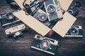 Retro film cameras on wooden background