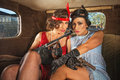 Retro gangster females in car pair of pretty s ladies Stock Photo