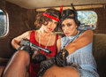 Retro gangster women in car pair of pretty s female gangsters Royalty Free Stock Image